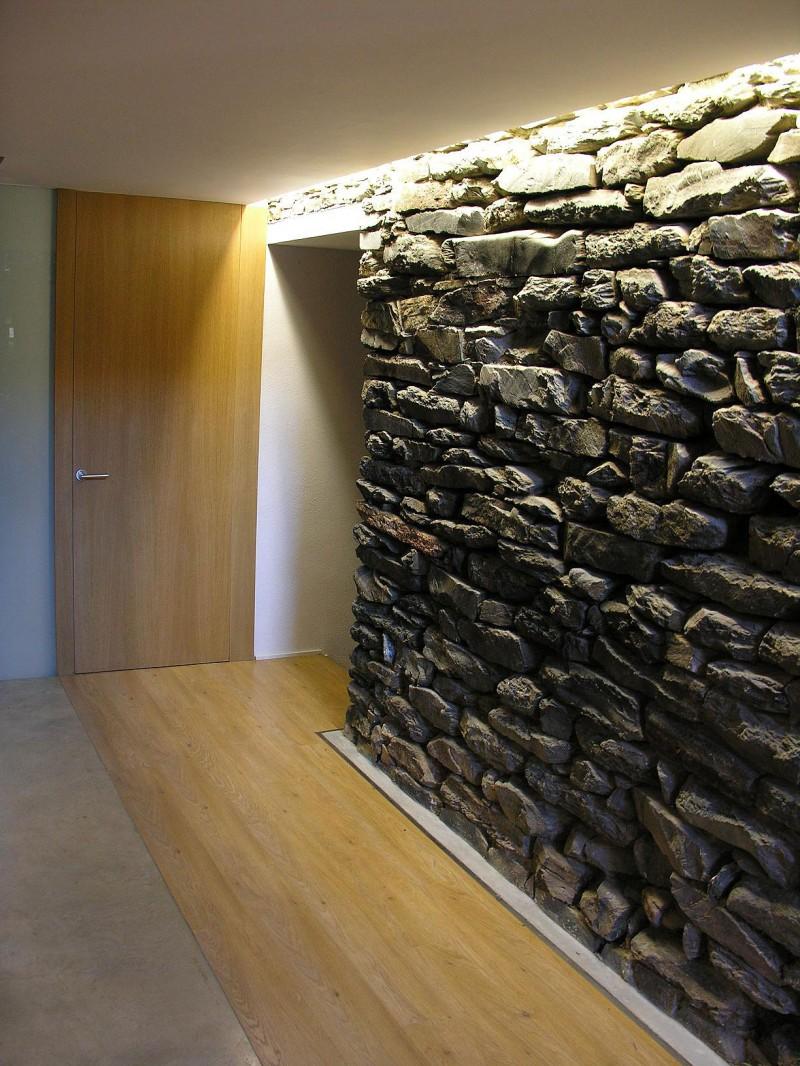 Interior stone wall lighting lilianduval mas la riba by ferran lpez roca arquitectura aloadofball Choice Image