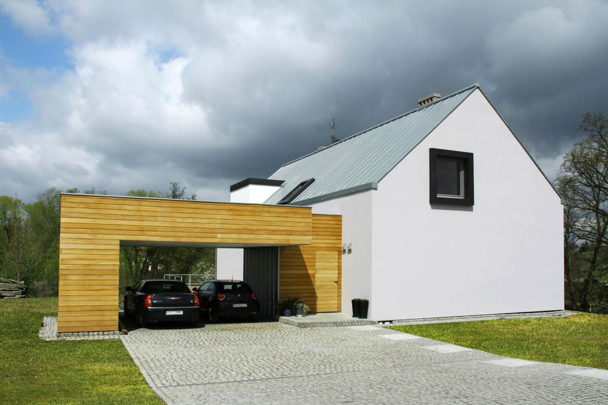 House in poznan by major architekci for Modern house with garage