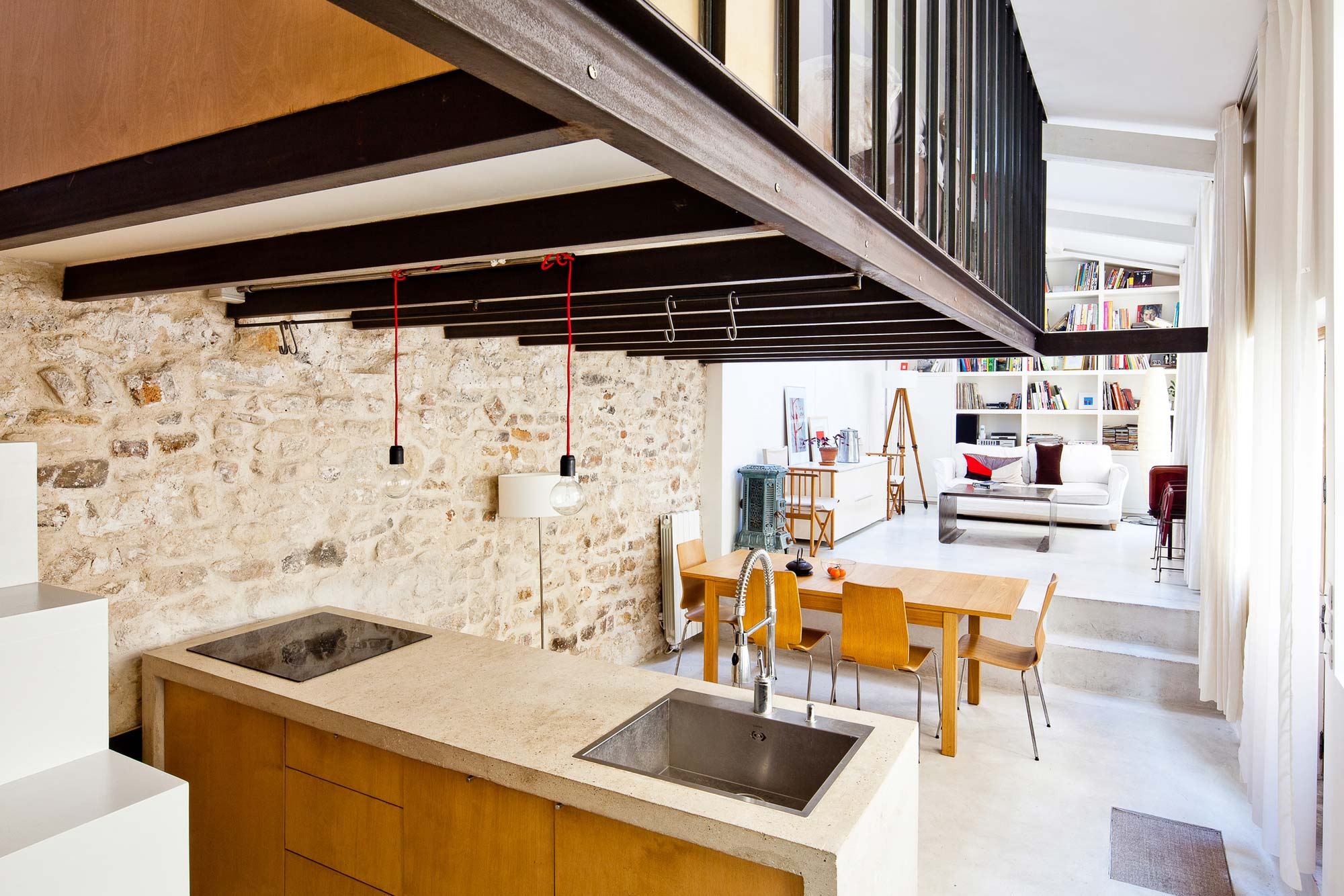 Transformation of a Studio into a Loft by NZI Architectes