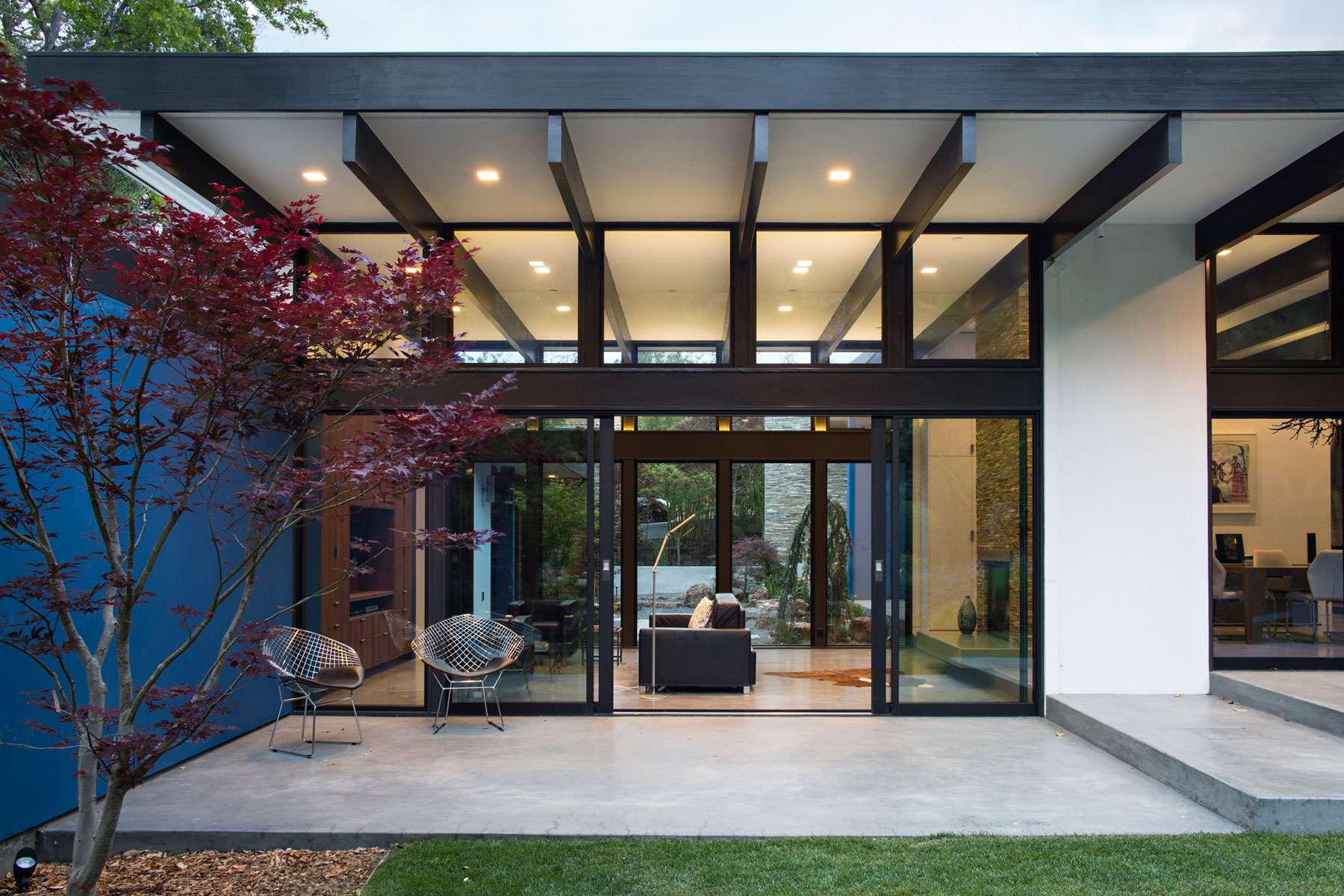 Modern atrium house by klopf architecture for House plans with atrium in center