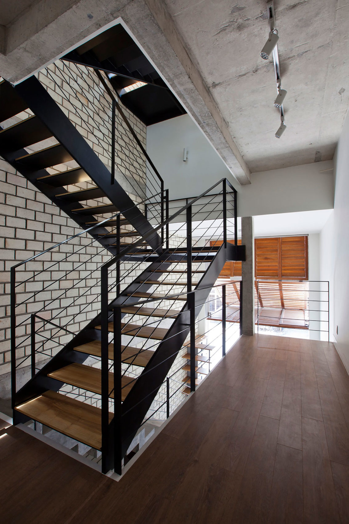 Townhouse with a Folding-Up Shutter by MM++ architects (11)