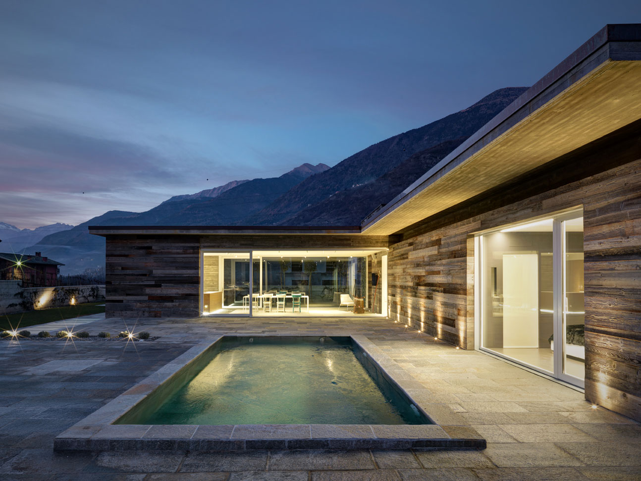 Rocco Borromini Designs a Cozy Stone Home Surrounded by the Stunning Mountains of Sondrio, Italy