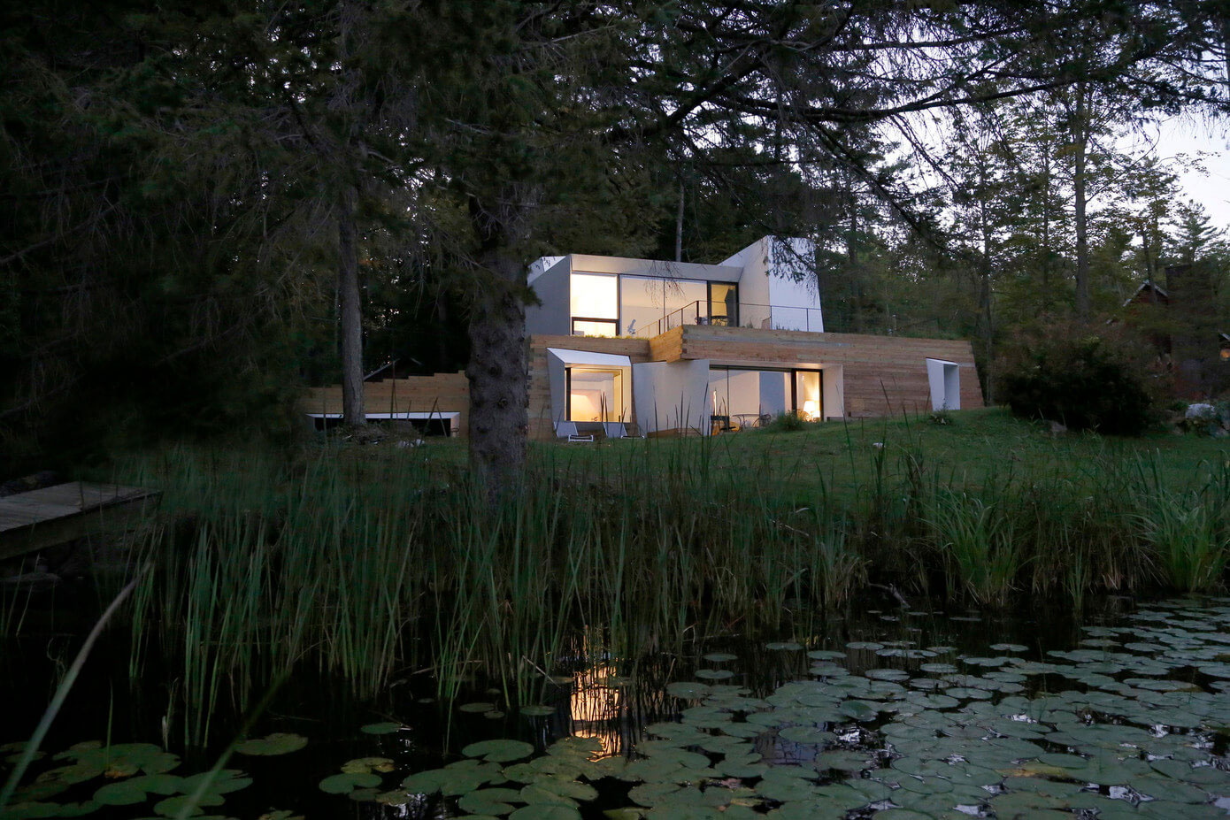 Taylor and miller architecture designs a unique lake house for Unique lake house plans