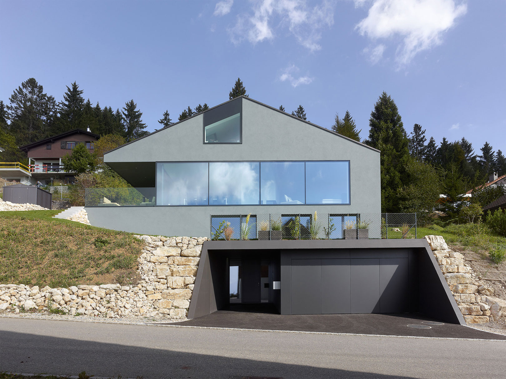 A Minimalist House Surrounded by Nature in the Swiss Jura ...