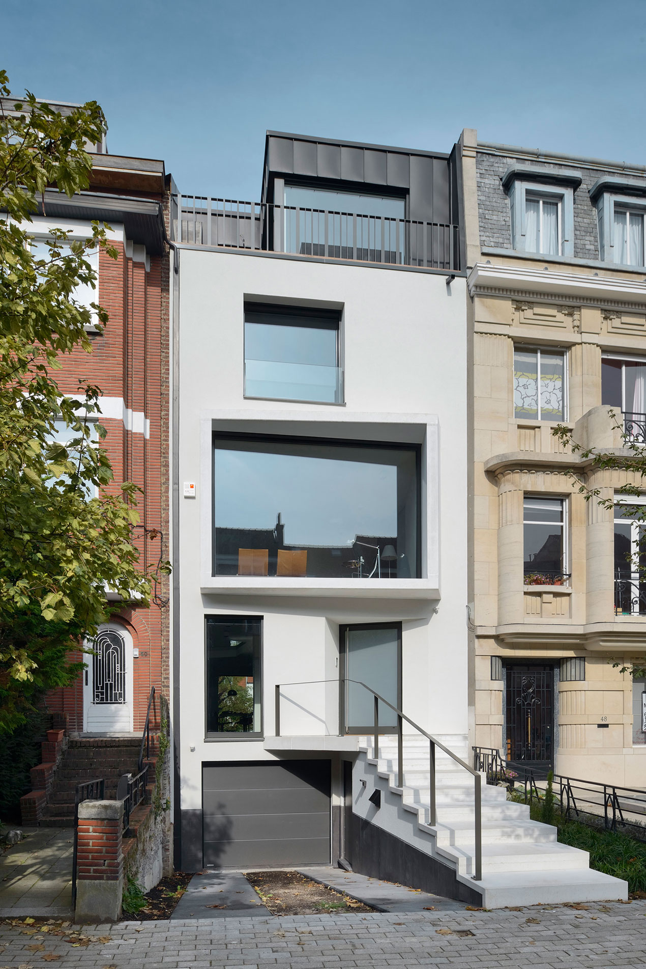 Urban Platform Designs a Vertical Home in Brussels, Belgium