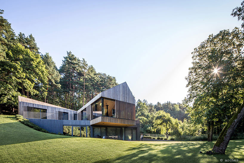 A wooden house on a verdant slope