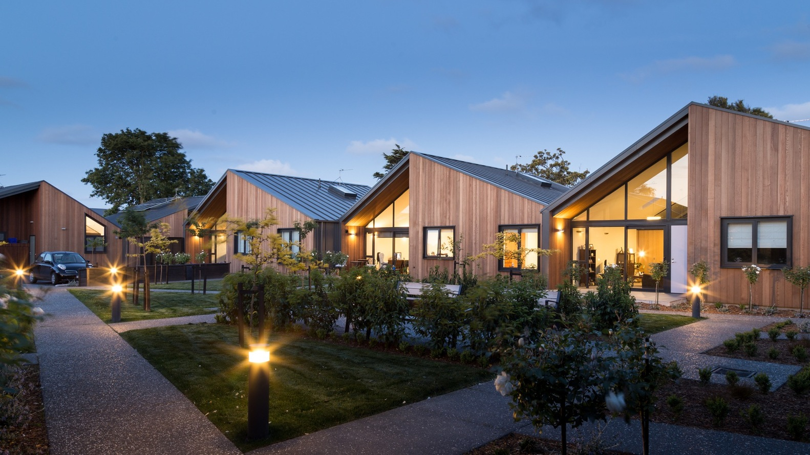 Warren and mahoney design a lovely 12 home community in for Christchurch architecture firms