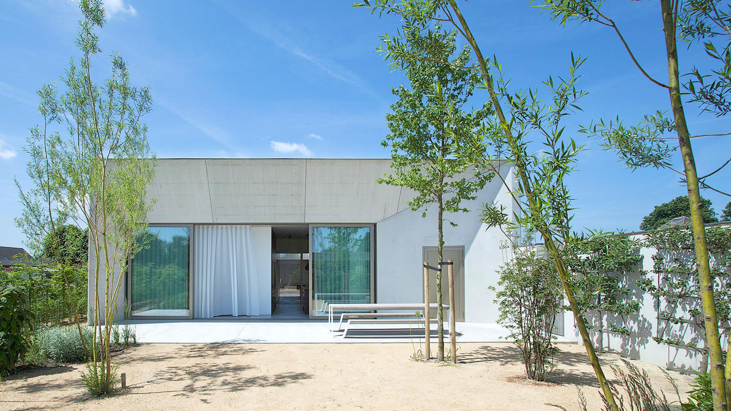 A Bright White Concrete Home Designed by Clauwers & Simon in Belgium
