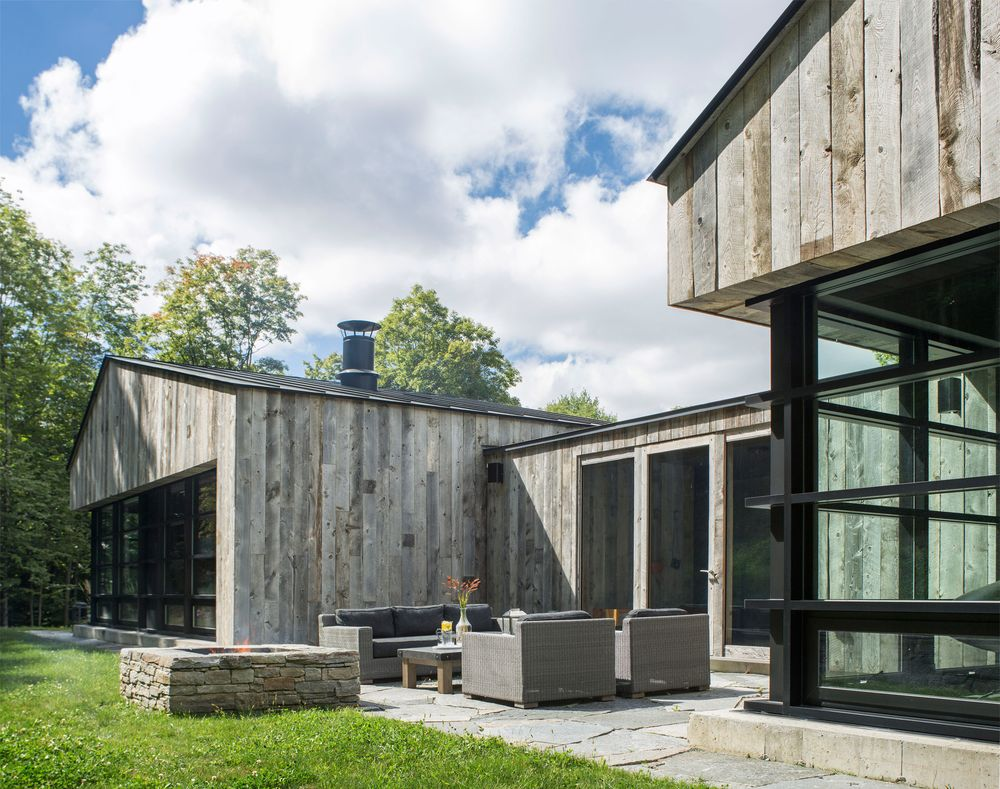 A Wooden Home surrounded by a forest  in Pomfret, Vermont