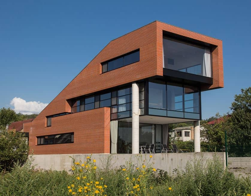 Wonderful House with a Modern Structure Built out of Red Brick and with Glass Walls Located in Dnipro, Ukraine