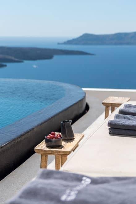 Wonderful Resort In Santorini Greece Overlooking The Deep Blue Of Sea
