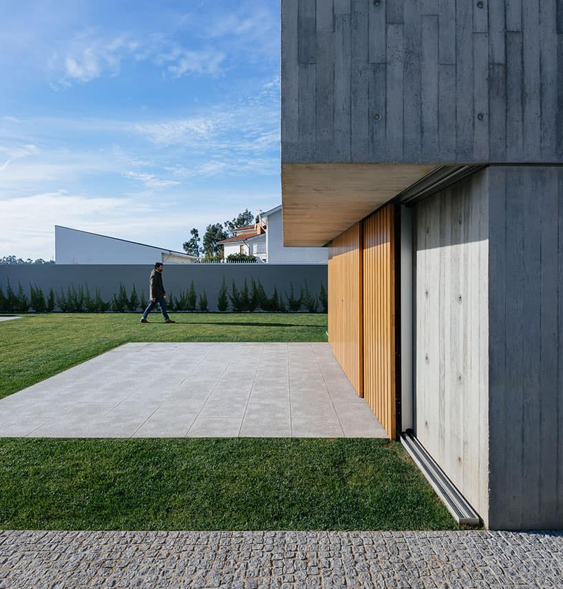 House with Facade in Concrete was Designed by Base Arquitetura in Porto, Portugal