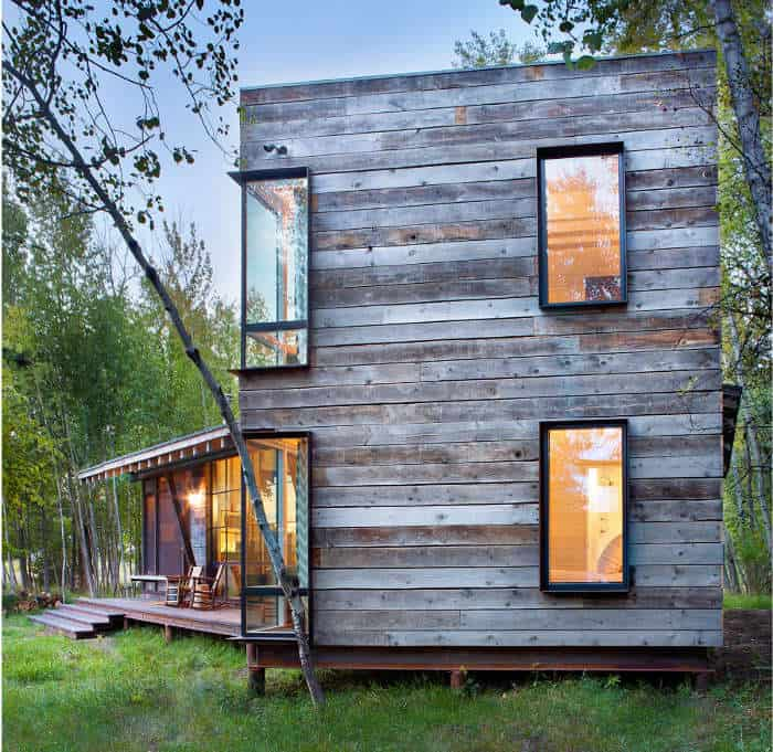 A Magnificent Log Cabin Located In The Mountains Of