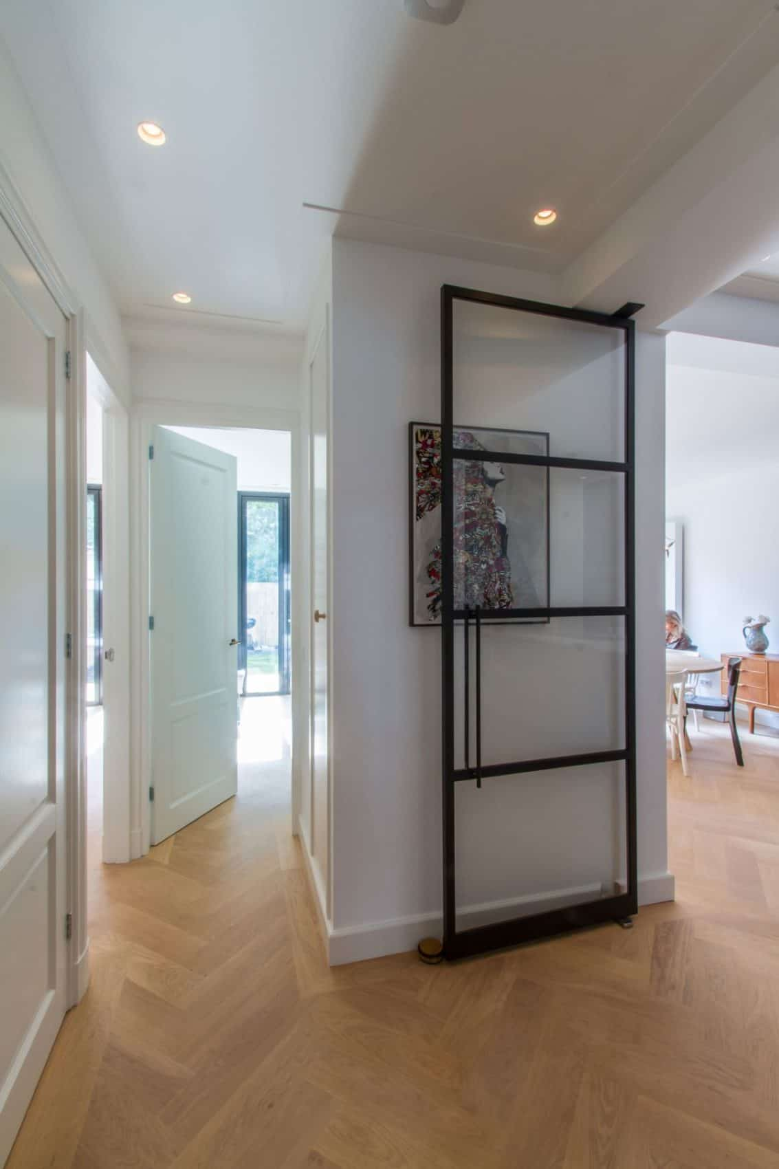 Cozy and Charming Space - Glass framed door and hardwood parquet floor