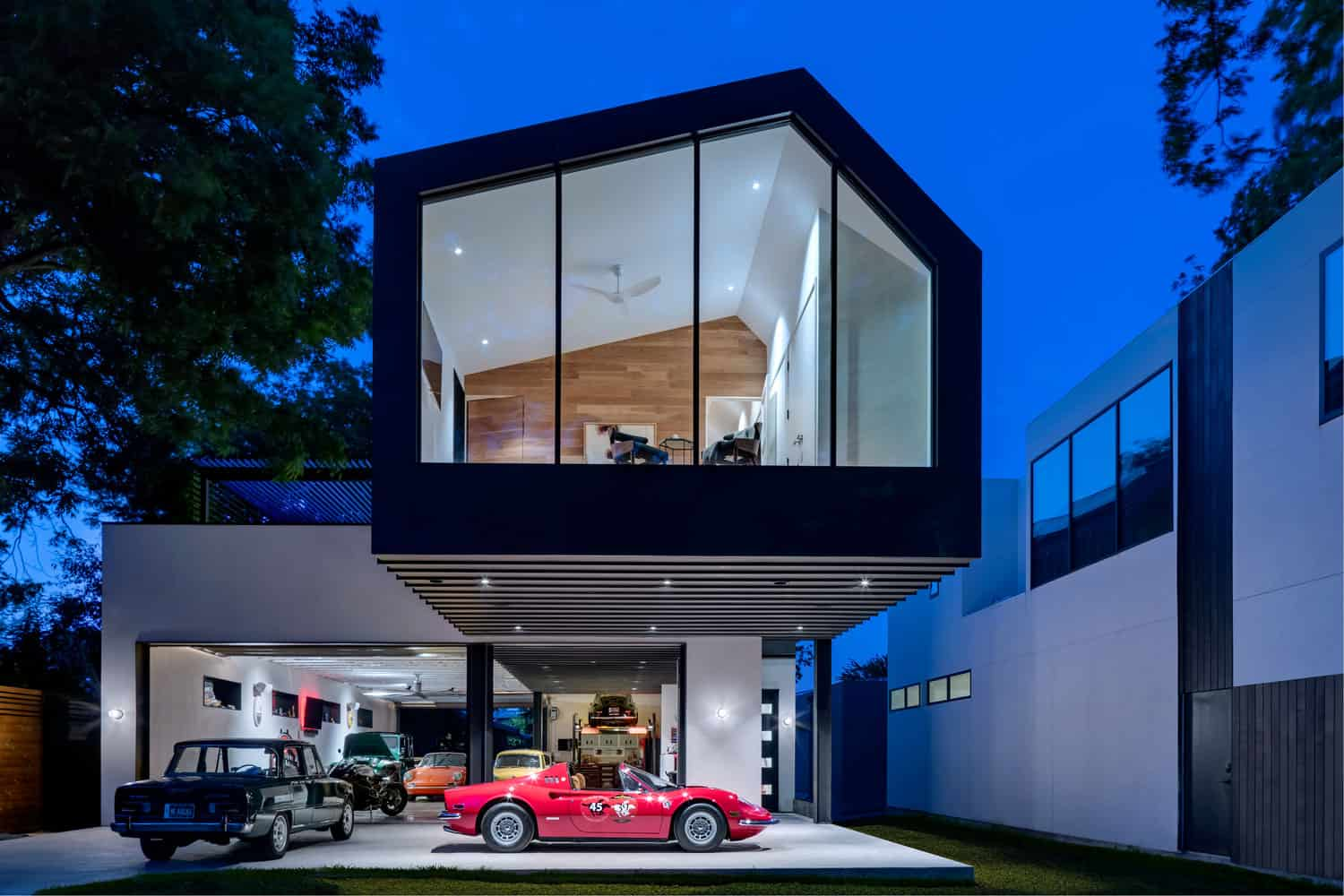Modern and Functional House which Doubles as a Car Collector's Garage and Private Residence