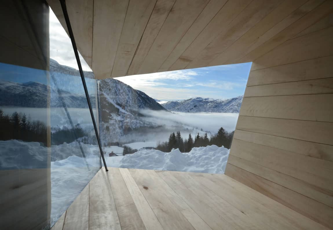 Wooden cabin interior with view to the mountains