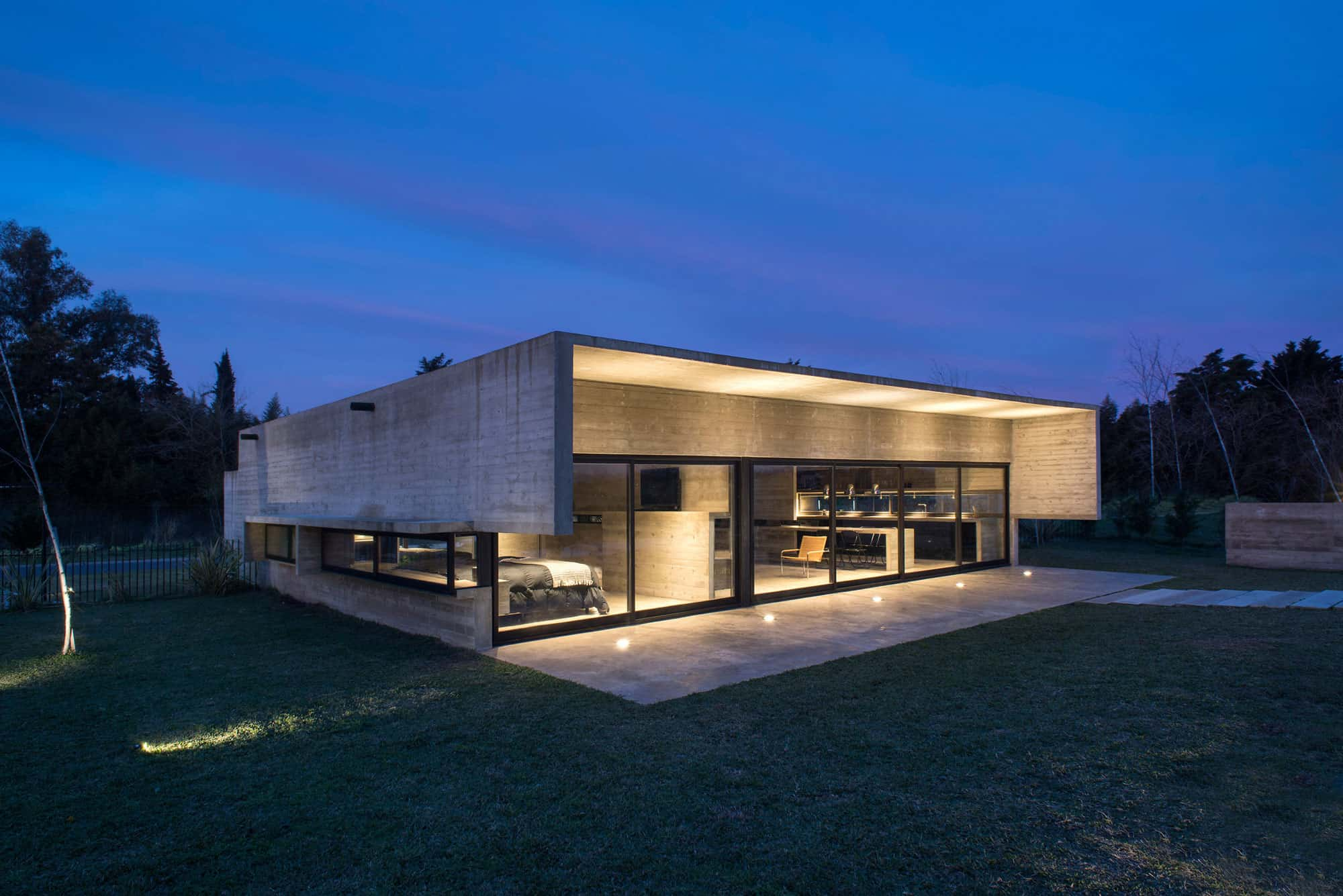 Spectacular Concrete House Surrounded By Fields And Vegetation