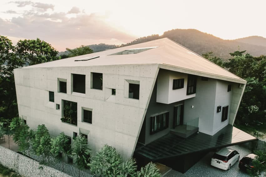 Imposing Concrete Construction Surrounded by Thick Green Vegetation
