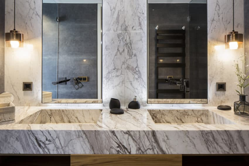Stunningly modern A 602 complex by theCATwork completed using marble as a lovely central feature