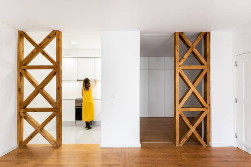 White and wood Apartment in historical building renovated by Santa Apolonia by SER-ra