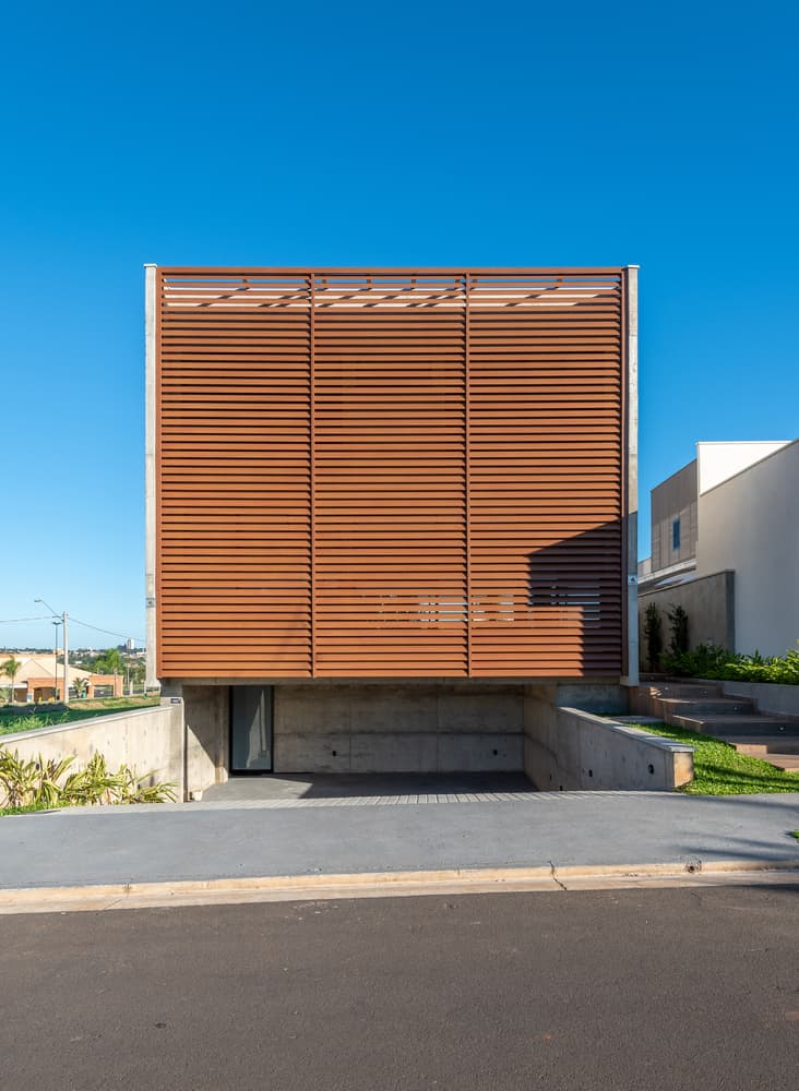 Wood and concrete Box House created by Caio Persighini Arquitetura to blend nature and a passion for music in a family home