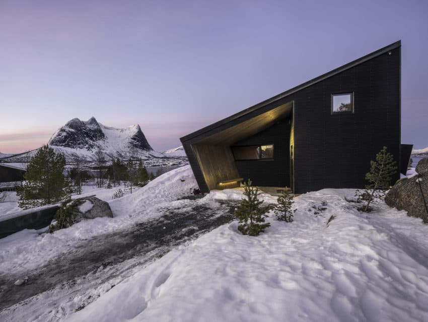 Uniquely shaped Efjord Retreat Cabin created by Stinessen Arkitektur in the waterways of Norway