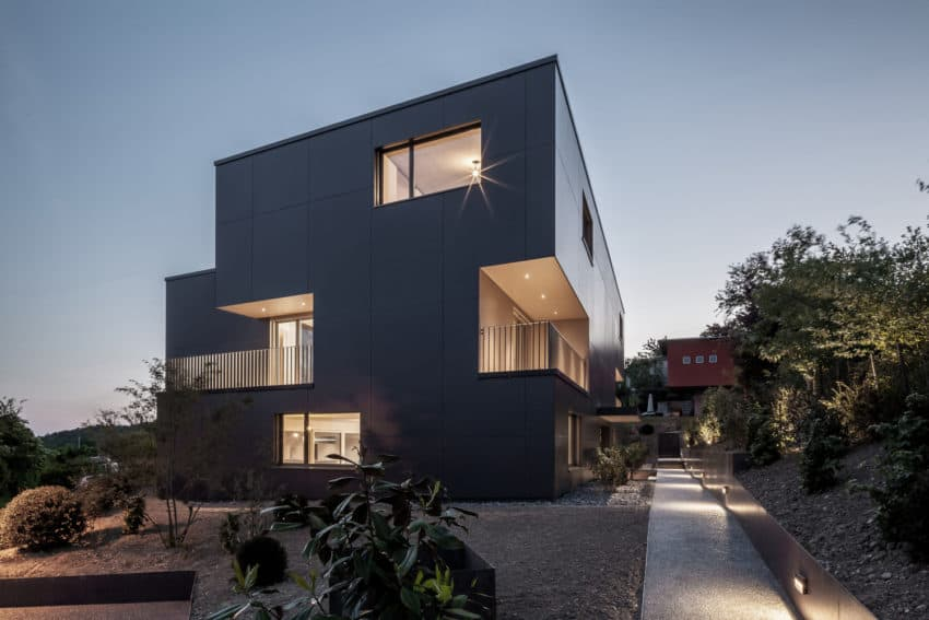 Black Prefab Multi Unit House Riedholz by Tormen Architekten AG