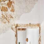 Exposed wall are a part of the new house that has undergone a budget makeover