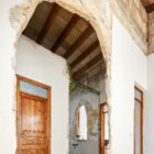 Irregular old archways inside the house were preserved and enhanced for a vintage appeal