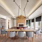 Large and open living area with wood and white color scheme and an impressive dining area